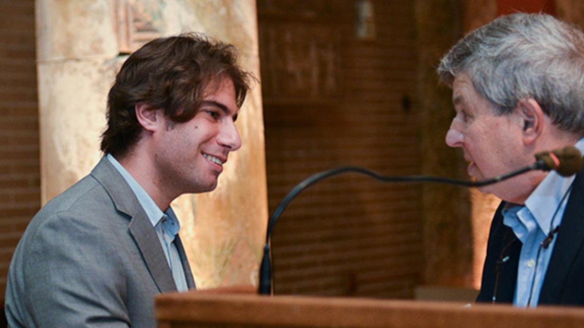 Felipe Saffie (left) received the Joel Popkin Graduate Student Teaching Prize in Economics from Joel Popkin (right).