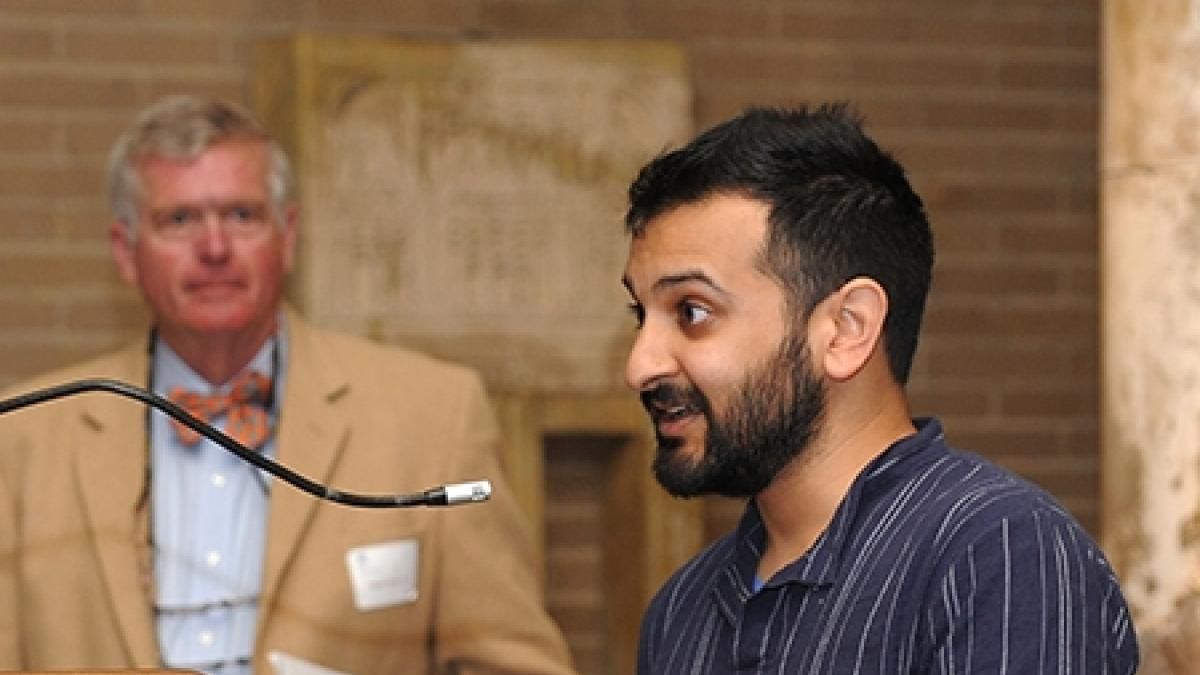 Nirav Mehta, one of the co-winners of this year's Carey Prize, expresses his thanks while Francis Carey III looks lon.